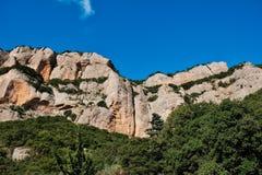 Rugged Mountain Rock Cliffs, Kalavryta, Peloponnese, Greece. Rugged bare rocky cliffs in Peloponnese mountains, near Kalavryta, with clear blue sky, Greece, with royalty free stock image