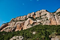 Rugged Mountain Rock Cliffs, Kalavryta, Peloponnese, Greece. Rugged bare rocky cliffs in Peloponnese mountains, near Kalavryta, with clear blue sky, Greece, with stock photo