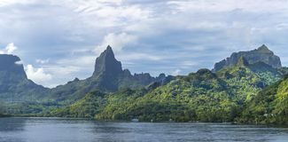 Polynesian Landscape. Rugged, mountainous landscape of Moorea in French Polynesia and the mountain of Bali Hai Royalty Free Stock Images
