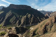 Rugged mountains with gorge and river. In Gran Canaria, Spain Royalty Free Stock Photography