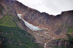 Mountains and ice fields near Hyder, Alaska. Rugged mountains and ice fields in low clouds near Hyder, Alaska stock image