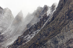 Rugged mountains in the winter fog. Known as Brecha de la Ventana (2609 m.); Ordesa and Monte Perdido National Park; Huesca; Spain Royalty Free Stock Photo