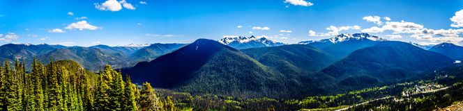 Panoramic view of the Cascade Mountain range in BC Canada. Rugged Peaks of the Cascade Mountain Range on the US-Canada border as seen from the Cascade Lookout stock images
