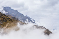 Rugged peaks showing above clouds at the Remarkables Ski Area, Q Royalty Free Stock Image