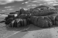 Rugged rock formation on a rocky beach Royalty Free Stock Photography