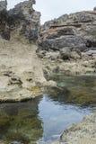 Rugged Rocks and Rock Pool, Mornington Peninsula, Australia. Stock Photos