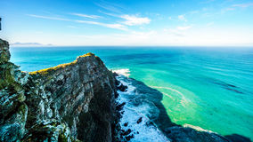 Rugged rocks and steep cliffs of Cape Point in the Cape of Good Hope Nature Reserve. On the southern tip of the Cape Peninsula in South Africa, surrounded by royalty free stock images