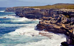Rugged sandstone cliffs of Cape Solander, Royalty Free Stock Images