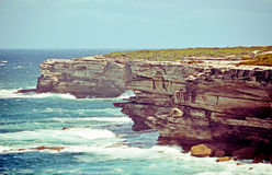 Rugged sandstone cliffs of Cape Solander, Royalty Free Stock Photos