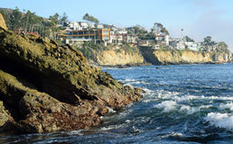 Rugged shoreline and cliff side homes in South Laguna Beach, California. Image shows the rugged shoreline and cliff side homes between Moss Point and Victoria Royalty Free Stock Image