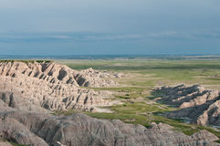 Rugged terrain in Badlands National Parl. Cloudy sky over rugged terrain of Homestead Overlook in Badlands National Park, South Dakota Royalty Free Stock Images