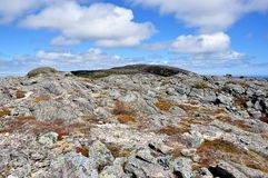 Rugged terrain in Newfoundland. Dramatic view of the rugged rocky terrain that makes up the top of a mountain near Bay Bulls, Newfoundland Stock Image