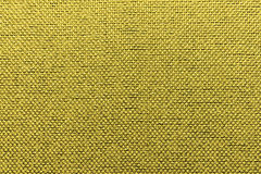 Rugged textile gold background Royalty Free Stock Images
