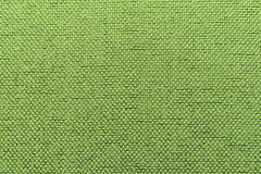 Rugged textile warm green background Stock Images