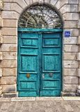 Rugged turquoise doors Stock Photos
