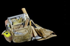 Rugged well used carpenters work bags with tools isolated on bla Royalty Free Stock Photos
