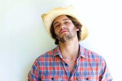Rugged young man wearing cowboy hat. Close up portrait of rugged young man wearing cowboy hat Stock Image