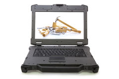 Ruggedized laptop with woodwork tools Stock Photo