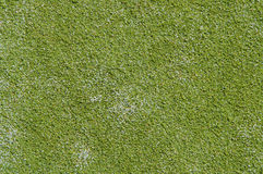 Rugose grass. Texture begins with a tennis court Royalty Free Stock Image
