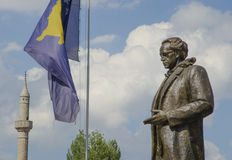 Rugova statue with Kosovo flag in Pristina Royalty Free Stock Image