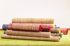 Rugs. Handmade rolled up rugs for flooring Stock Images