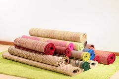 Rugs. Handmade rolled up rugs for flooring Stock Photography