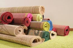 Rugs. Handmade rolled up rugs for flooring Royalty Free Stock Photography