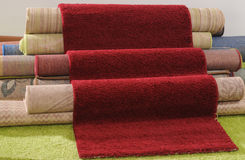 Rugs. Handmade rolled up rugs for flooring Stock Photo