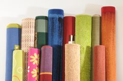 Rugs. Handmade rolled up rugs for flooring Royalty Free Stock Photo