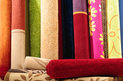 Rugs. Handmade rolled up rugs for flooring Royalty Free Stock Images