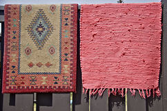 Rugs hanging out for Spring Cleaning. Two small area rugs are hung outside to be aired out and dusted out as part of spring cleaning Stock Photography