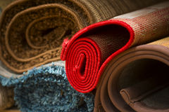 Rugs in rug store. Heap of rolled up rugs in rug store Stock Photography