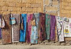Rugs for sale. Fabrics and rugs hung up for sale to tourists on the walls of Jaisalmer Fort, Rajasthan Royalty Free Stock Photography