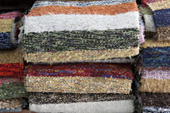 Rugs on shelves Royalty Free Stock Photography