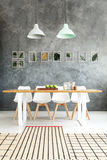Rugs with stripes. Small rugs with stripes placed on one another in dining room with raw wall Royalty Free Stock Photo