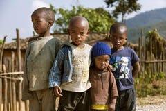 RUHENGERI, RWANDA - SEPTEMBER 7, 2015: Unknown kids who hug each other. Royalty Free Stock Images