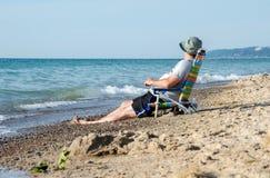 Ruhestand auf dem Strand Stockfotografie