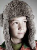 ruhiges Kind mit Kaninchenhut Stockfotografie