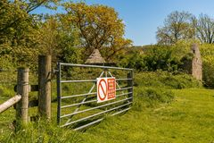 Tyneham Village, Jurassic Coast, Dorset, UK. Ruin in the abandoned Tyneham Village and a gate, near Kimmeridge, Jurassic Coast, Dorset, UK Stock Photo
