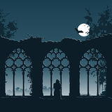 Ruin of an abbey. Illustration showing a monk entering the ruins of an old gothic abbey at night Royalty Free Stock Photos