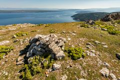 Ruin of an ancient chapel, pile of rocks, view over the adriatic. Sea to island of Krk Croatia Stock Images
