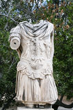 Ruin of ancient statue in urban park in Athens Stock Photo