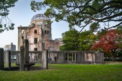 The Ruin of the Atomic Bomb Dome in Hiroshima, Japan. The Ruin of the Atomic Bomb Dome in Hiroshima at sunset on the side of Motoyasu River in Japan, a symbol royalty free stock image