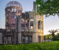 The ruin of the Atomic Bomb Dome in Hiroshima at sunset. On the side of Motoyasu River in Japan, a symbol of the destruction of the atomic blast in world war royalty free stock photography