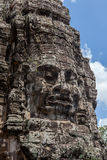 Ruin bayon stone face at gateway of Angkor Wat, Siem Reap, Cambo Stock Photography