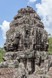 Ruin bayon stone face at gateway of Angkor Wat, Siem Reap, Cambo Royalty Free Stock Image