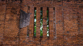 Ruin brick wall with window and tree behind in ancient temple, A Royalty Free Stock Image