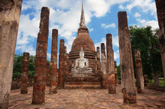 Ruin of Buddha. A photo of Buddha sitting in front of a pagoda, with ruin of stone pillars, is a World Heritage at Sukhothai Historical Park, Sukhothai, Thailand Stock Photos