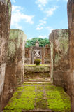 Ruin of Buddha Sitting behind the wall under the blue sky. Is a World Heritage at Wat Sri Chum temple, Sukhothai, Thailand Royalty Free Stock Photography