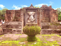 Ruin of buddha statue behind the ruin Stock Photography
